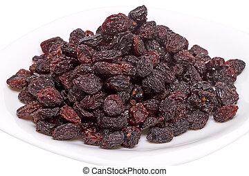 Heap of raisins on a white plate