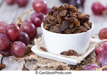 Heap of Raisins on vintage wooden background