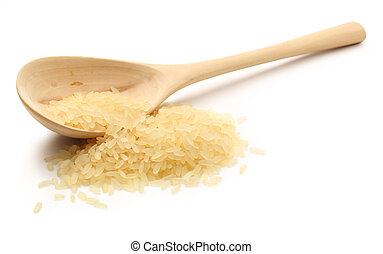 Heap of rice with wooden spoon
