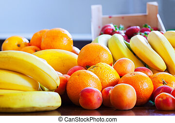 Heap of ripe fruits on kitchen