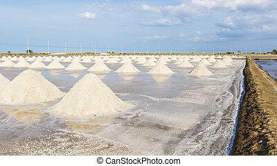 Heap of sea salt in salt farm ready for harvest.