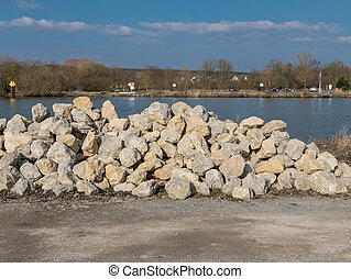 Heap of stones at the harbor