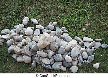 heap of stones on the grass