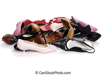 heap of the ladies' shoes on white