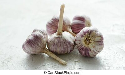 Heap of unpeeled garlic bulbs - Closeup shot of composed...