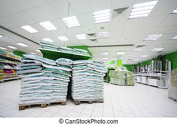 Heap of variety of fertilizer and material for gardening inside large supermarket