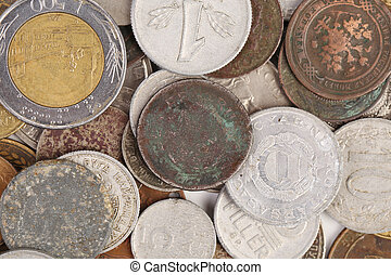 Heap of various coins and a gold