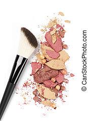 Heap of various crashed makeup products