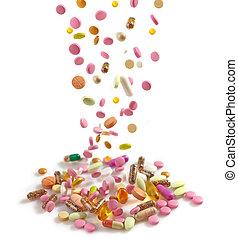 heap of various pills on white background