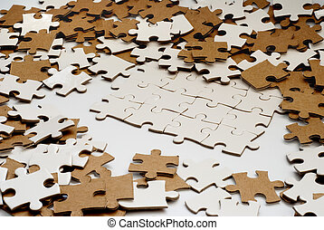 puzzle pieces - heap of white and brown puzzle pieces