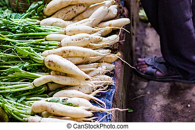 heap of white radish in retail vegetable super market for sale