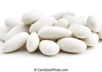heap of  white sugared almonds on white background
