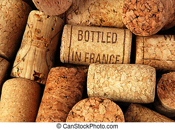 corks - heap of wine bottle corks, one of them with...