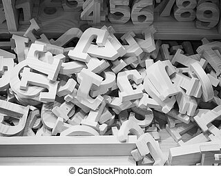 Heap of wooden alphabets and numbers,