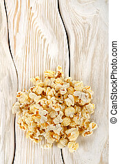Heap popcorn on white table
