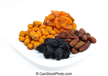 Heaps of dried fruits: prunes, dates, apricots