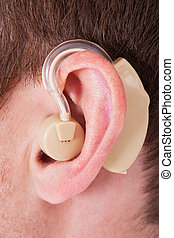 Hearing Aid On The Man's Ear - Close-up Of Hearing Aid On...