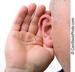 hearing - close up of a hand cupping an ear to hear better ...