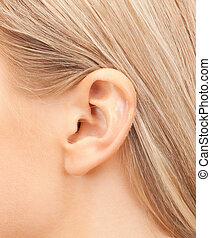 close up of woman's ear