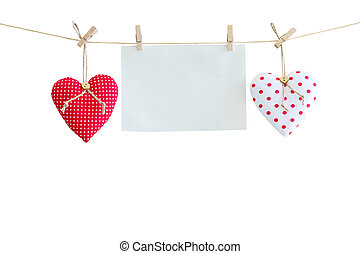 Heart and balnk paper hanging on isolated white with...
