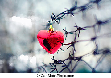 Heart and barbed wire. Love symbol.