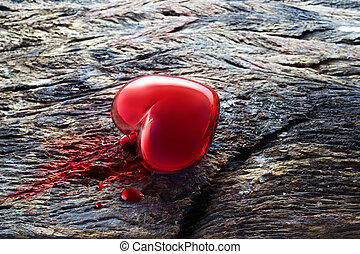 heart and blood on wooden background, medical symbol concept