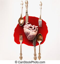 Heart and cutlery in a blood pool