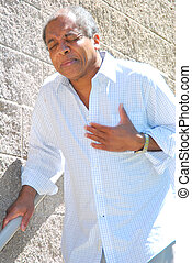 Heart Attack - African american man having a heart attack.