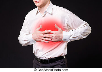 Heart attack, man with chest pain on black background