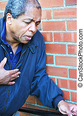 African american male having a heart attack.