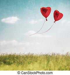 Heart balloon in blue sky