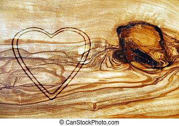 heart carved on an old wood