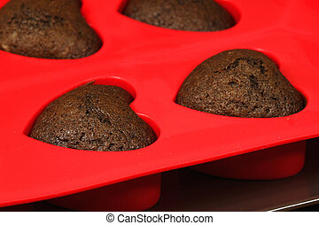 Heart cookies - Brown chocolate cupcakes heart-shaped in red...
