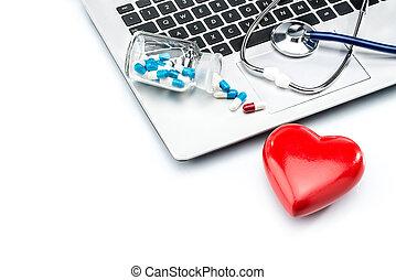 Heart disease research, stethoscope and heart shape on laptop keyboard
