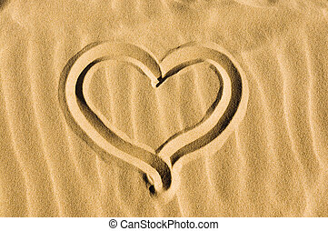 Heart drawn in the sand