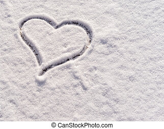 heart drawn in the snow as a background for postcard.