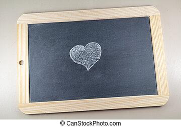 Heart drawn on a chalkboard slate
