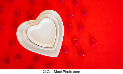 Heart form white plate on red background