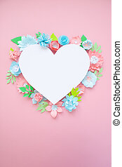 Heart frame with paper flowers on pink background. Cut from paper.