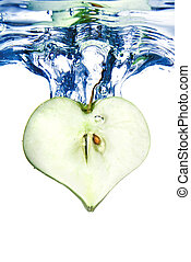 heart from green apple in water with splash isolated on white