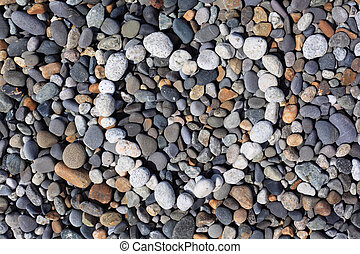 Heart from stones on pebble