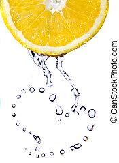 heart from water drops on lemon isolated on white