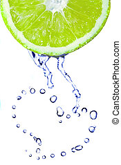 heart from water drops on lime isolated on white