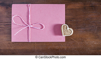 heart gingerbread cookies, red envelope on dark wooden background valentine's day