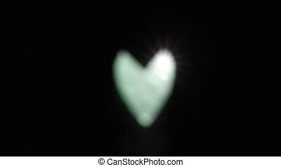 heart glowing light on isolated black