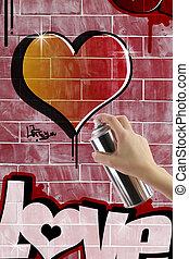 Heart graffiti on red brick wall