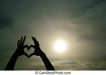 heart hand shadow - love sign by hand shadow with a sun...