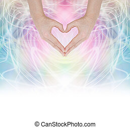 Hands forming a heart shape on a swirling pastel rainbow energy background fading into white at the base