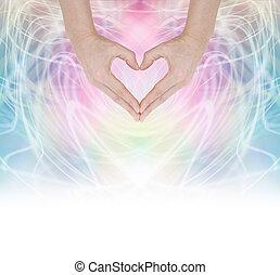 Heart Healing Energy - Hands forming a heart shape on a...