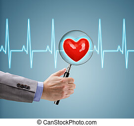 Heart health checkup, doctor with magnifying glass on a...
